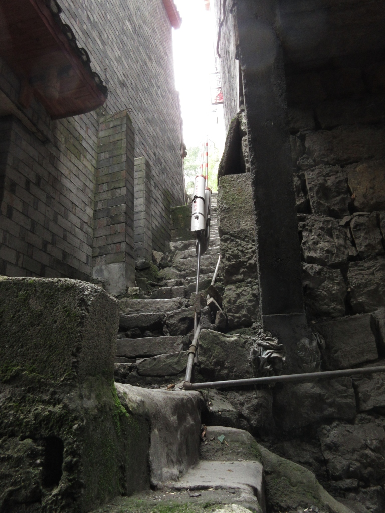 My favorite area of Jishou. Packed onto a steep riverbank without a road, its twisting narrow alleys feel like they're built on top of generations of human civilization