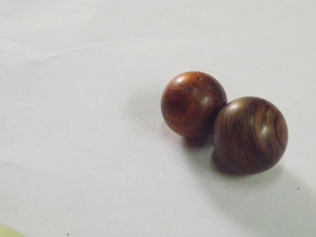 Two beads for bracelets, made of Chinese Yew (left) and Nanmu (right)